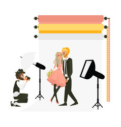photographer shooting a wedding couple in studio vector image