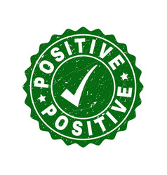 positive scratched stamp with tick vector image