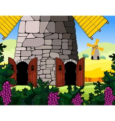 Windmill with open doors in the field vector