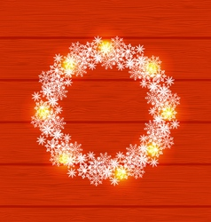Christmas circle frame made in snowflakes on red vector image