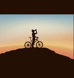 Cyclist on edge vector