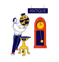 man visiting antique store flea market or garage vector image