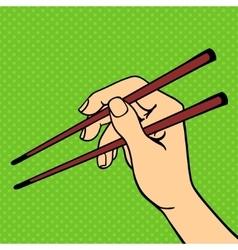 Human hand holding sushi sticks vector
