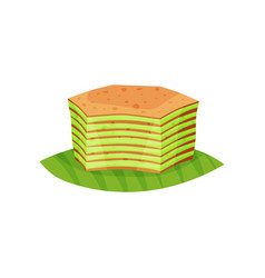 Tasty layered cake spekkoek on green leaf vector
