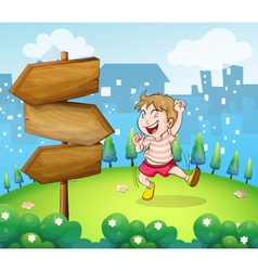 A young boy playing beside the wooden arrowboard vector image