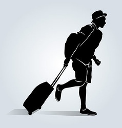 Silhouette of a tourist with a suitcase vector image