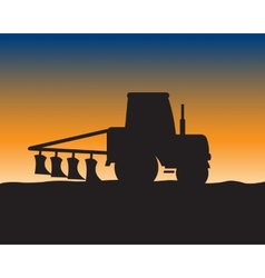Silhouette of the tractor in field vector