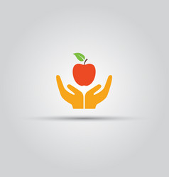 two human hands offering red apple colored icon vector image