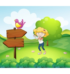A woman dancing near an arrow board with a bird vector image vector image