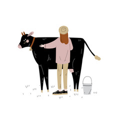 woman standing next to spotted cow dairy cattle vector image