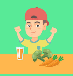 boy sitting at the table with fresh carrot juice vector image