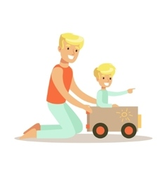 Dad And Son Playing With Cardboard Car Loving vector image