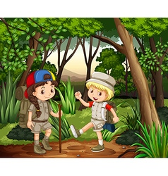 Boy and girl camping in the woods vector image