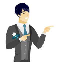 young asian groom pointing to the side vector image vector image