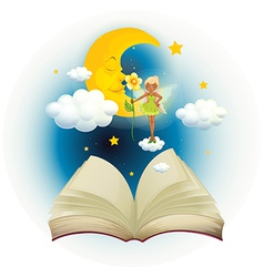 An open book with an image of a fairy and a vector image
