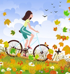 Beautiful girl is riding on a bicycle in a autumn vector image