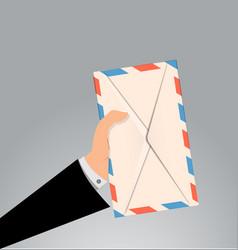 Hand holding envelope letter vector