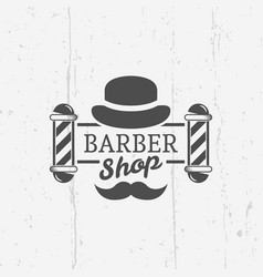 barber shop pole with gentleman hat emblem vector image