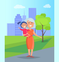 Middle-aged woman with granddaughter in hands vector