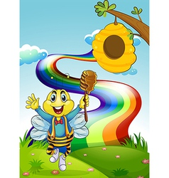 A happy bee at the hilltop with a rainbow vector image