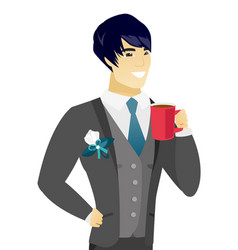 Young asian groom holding cup of coffee vector
