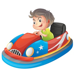 A young boy riding a bumper car vector image