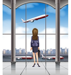 Woman looking at the plane taking off vector