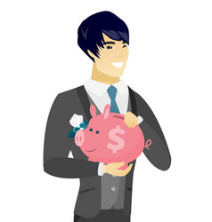 young asian groom holding a piggy bank vector image