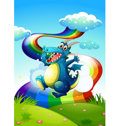 A dragon at the hilltop and a rainbow in the sky vector