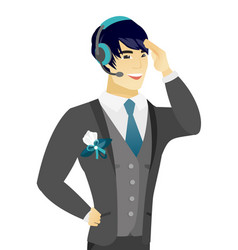 Young asian groom in headset vector