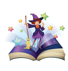 An open book with an image of a witch holding a vector