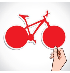 Red bicycle sticker in hand vector