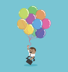 a black businessman flying with balloons business vector image vector image