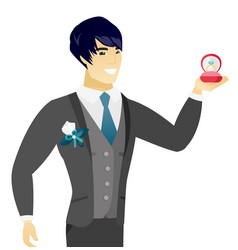 young asian groom holding wedding ring in box vector image vector image