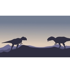 Silhouette of mapusaurus on the hill scenery vector image vector image