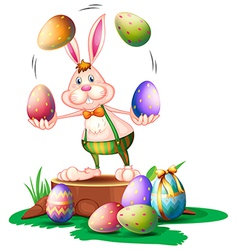A bunny juggling the easter eggs vector image vector image