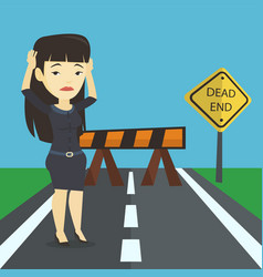 business woman looking at road sign dead end vector image