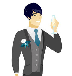 Young asian groom holding glass of champagne vector