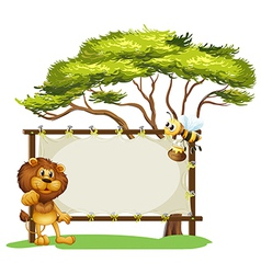 A lion and a bee near a big tree vector image vector image