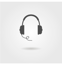 black headphones icon with shadow vector image