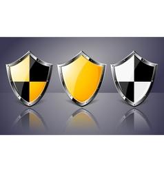 Set of Steel Shields over dark background vector image