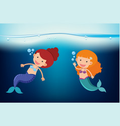 Two mermaids swimming under the sea vector