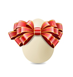 Chicken egg and red bow vector