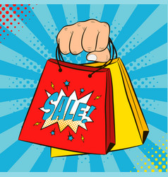 hand with shopping bags vector image