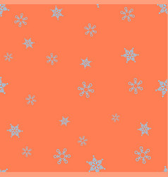 blue snowflakes on a orange background seamless vector image