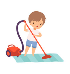 Cute boy cleaning floor with vaccuum cleaner vector