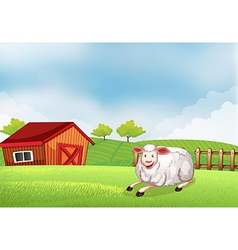 A sheep lying on the farm with a barn vector image