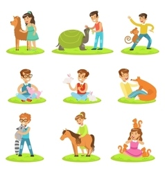 Children petting the small animals in petting zoo vector