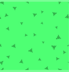 green christmas tree on a light green background vector image