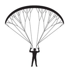 Black silhouette of a man with a paraglider vector image